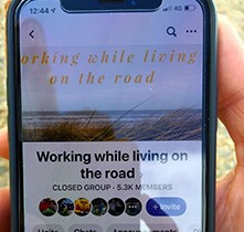 Image of phone showing website for working while travelling