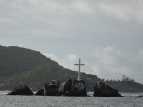 The cross marks the mouth of the bay.