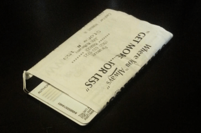 Two cards, rolled and Taped to their receipt.  The folded edges mean the cards have a $0 balance.