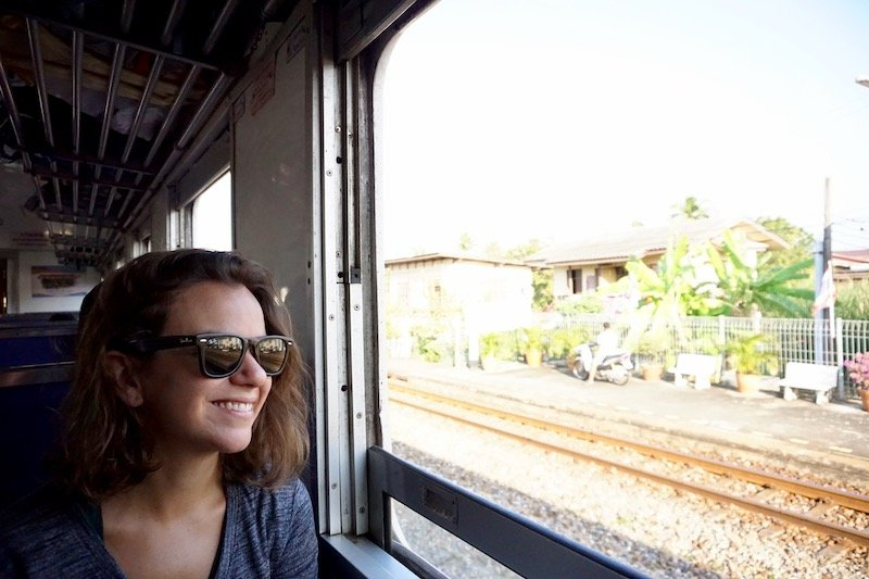 Woman on the train in Thailand with the window down