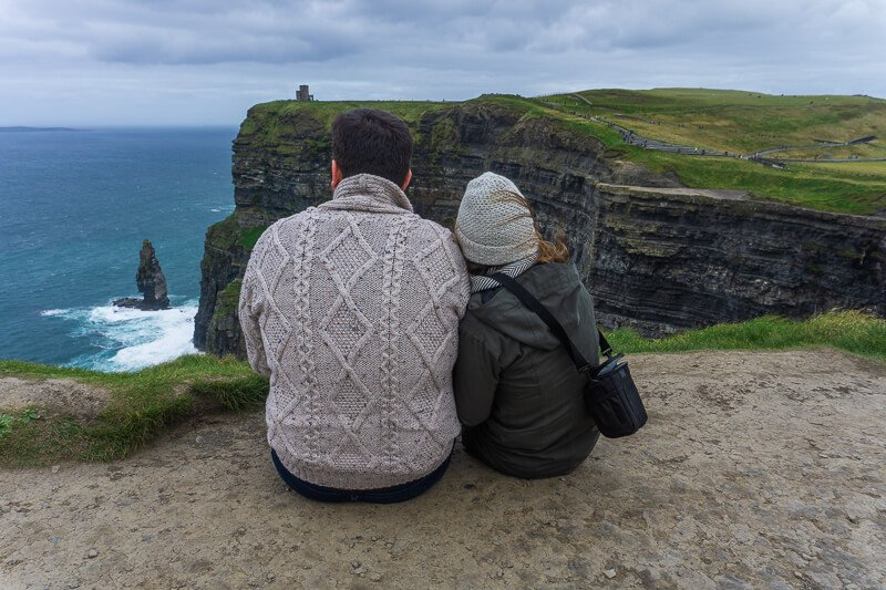 Couple overlooking the cliffs of moher