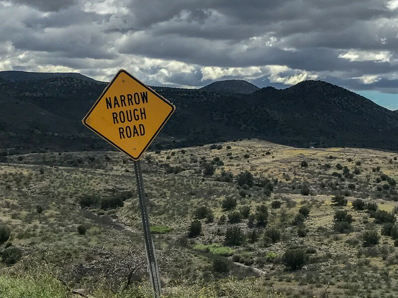Narrow rough road sign