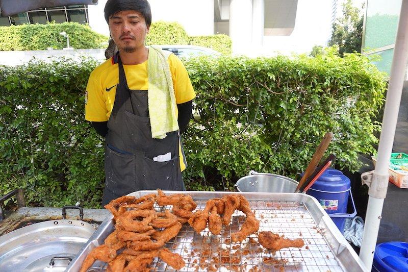 Man in Bangkok selling Fried Chicken on Street Corner