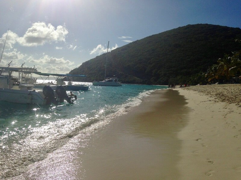 Boat and beach view on Jost Van Dyke