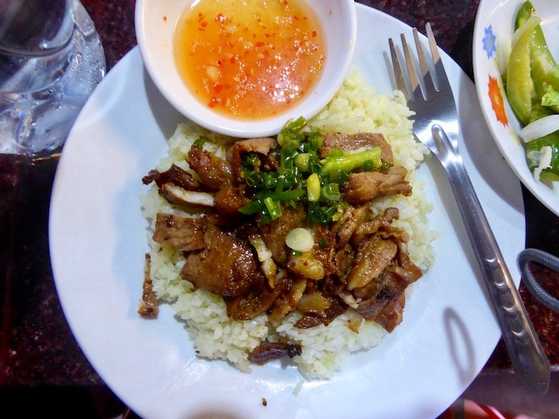 Roast pork and white rice from a Cambodian Market