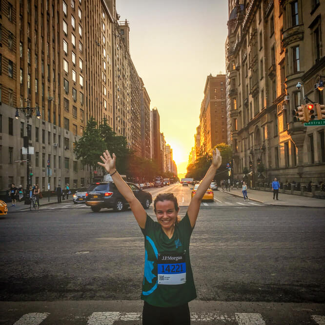Woman in Street after Run in NYC at Sunset