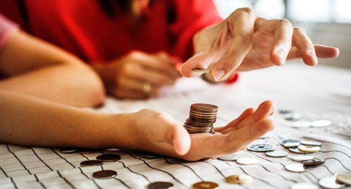 Counting coins into hand