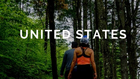 Hiking in Woods text overlay United States