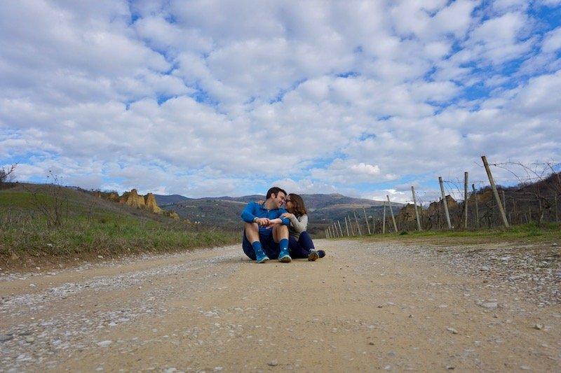 Tuscany Road Couple Sitting Together