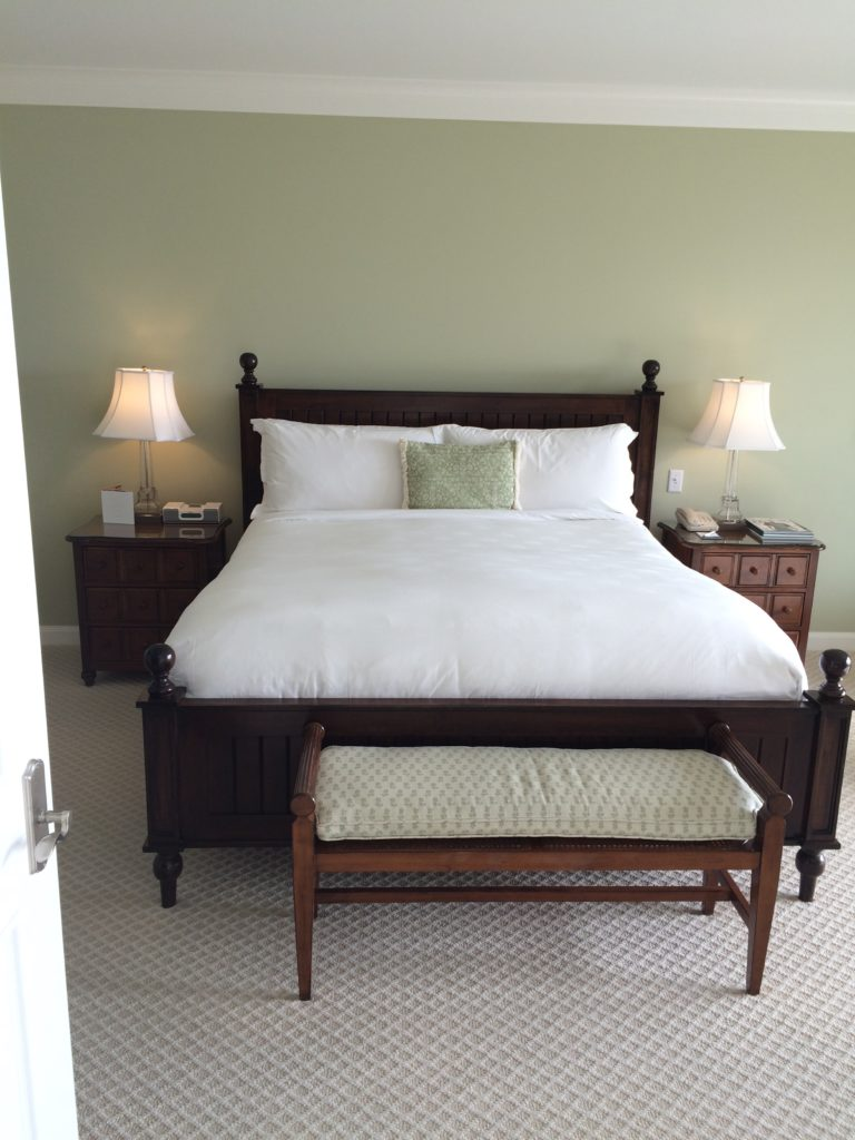 The king bed in the main bedroom