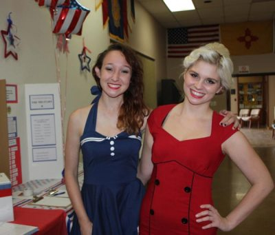 Girls in red and blue dressses