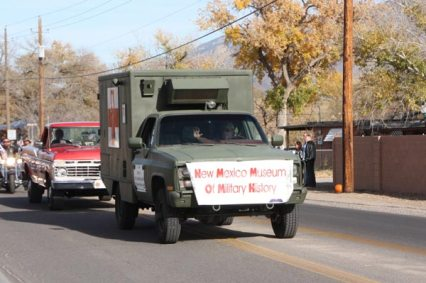 Miltary Truck with sign in parade