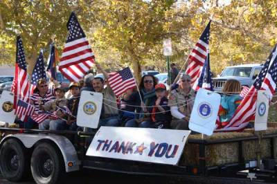 Flags with Thank you sign in parade