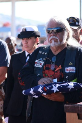 Wolfman holding memorial flag