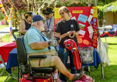 Circe Olson talking to man in wheelchair