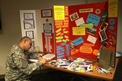 Military man writing postcard