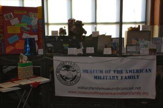 Table with Museum of the american military family banner