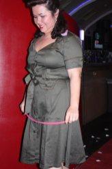 Model in tan dress
