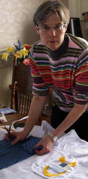 Circe Olsen cutting out apron