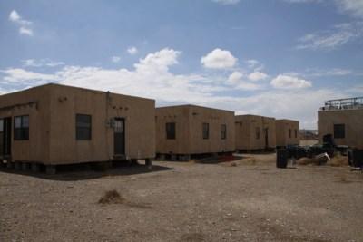 5 small adobe houses on blocks