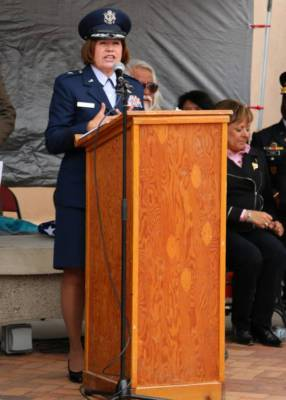 Woman in military uniform at podium