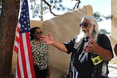 Wofman with woman by flag