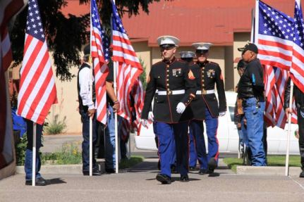 Marines marching by flags