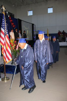 Two older men with caps and gowns