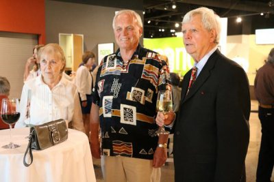 Joan and Allen Olson with man in patterned shirt