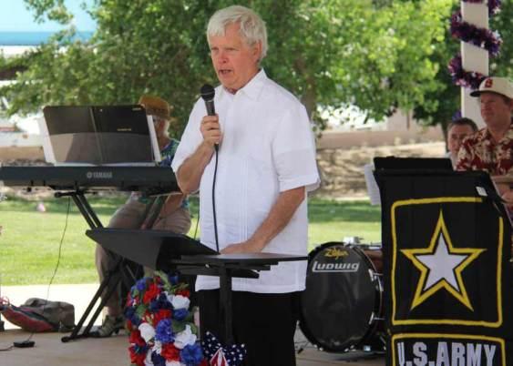 Allen Olson holding microphone