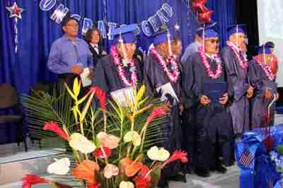 Jemez Pueblo veterans in cap and gown in special graduation ceremony
