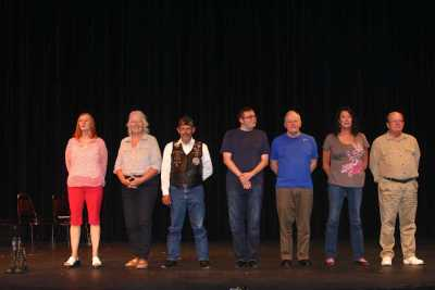 Cast of the telling project on stage in line