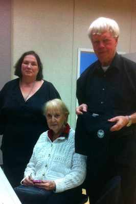 Jude with Allen Olson and Joan Olson (seated)