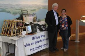 Allen Olson and woman at Operation Footlocker table at Salute to Heroes Veterans Day Celebration 2014