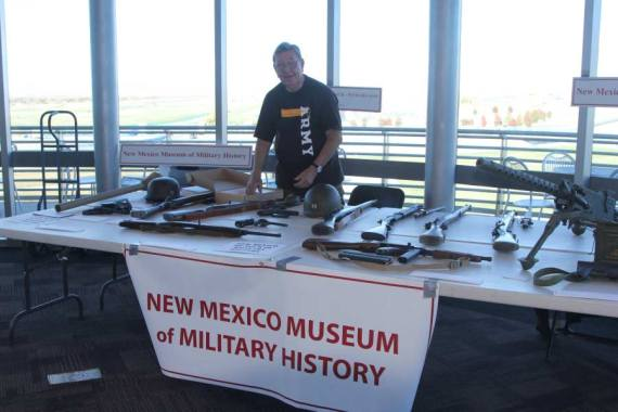 Man standing behind New Meixco Museum of Military History booth at Salute to Heroes Veterans Day Celebration 2014