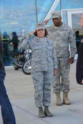 Man and woman saluting