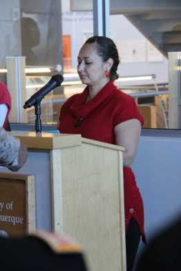 Woman at podium at Salute to Heroes Veterans Day Celebration 2014