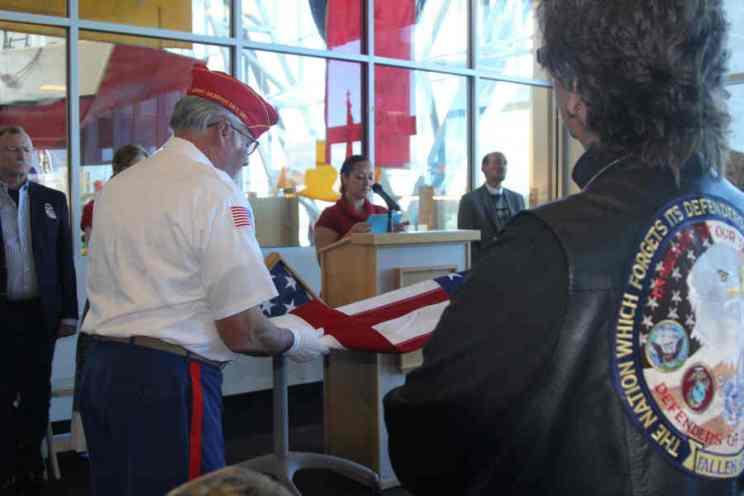 Veterans folding flag at Salute to Heroes Veterans Day Celebration 2014