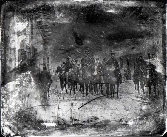 American troops ride into the city of Saltillo during the the war with Mexico. This early photograph, known as a daguerrotype, is one of the first images of a war ever captured on film. It was taken in 1847.