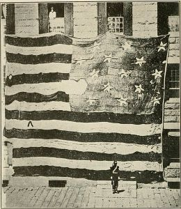 An 1878 photograph of the original Fort McHenry flag. Image courtesy of WikiCommons.
