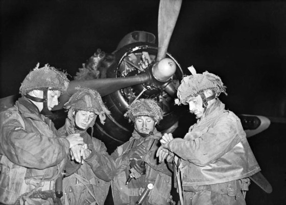British pathfinders synchronize watches before boarding a C-47 for Normandy. More than 300 pathfinders dropped into Europe ahead of the June 6 invasion. For more than an hour, they were the only Allied troops in France.