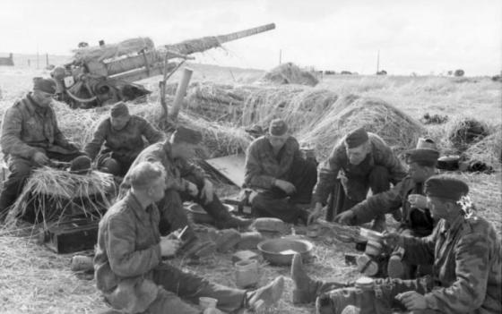 A German gun crew relaxes next to their 88 mm. The famous flak gun became one of the most feared anti-tank weapons of the Second World War, serving everywhere from the sands of North Africa to the snowy wastelands of the Russian front.