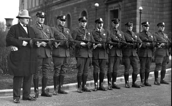 Policemen proudly display their new Thompsons.