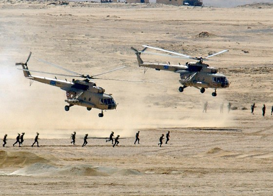 Two Soviet-made Egyptian Mi-8 Hip helicopters lift off after dropping of Egyptian Army soldiers during war-games in 2002. (Image source: U.S. Dept. of Defense)