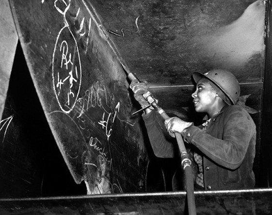 Eastine Cowner gave up her waitressing job to help build Liberty Ships in Richmond, Calif. during World War Two. She is seen here putting the finishing touches on the SS George Washington Carver launched on May 7, 1943. (Image source: WikiCommons. Photo by E. F. Joseph.)