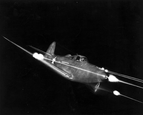 A P-39 tests its guns in the dark. (Image source: WikiCommons)