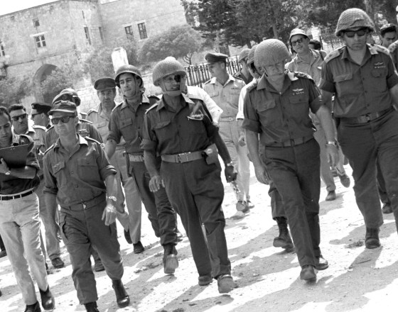 Moshe Dayan (center) and Yitzhak Rabin (second from right) in the Old City of Jerusalem. (Image source: WikiCommons)