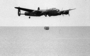 "A RAF Lancaster test drops an ""Upkeep"" dam-busting bomb. (Image source: WikiCommons)"