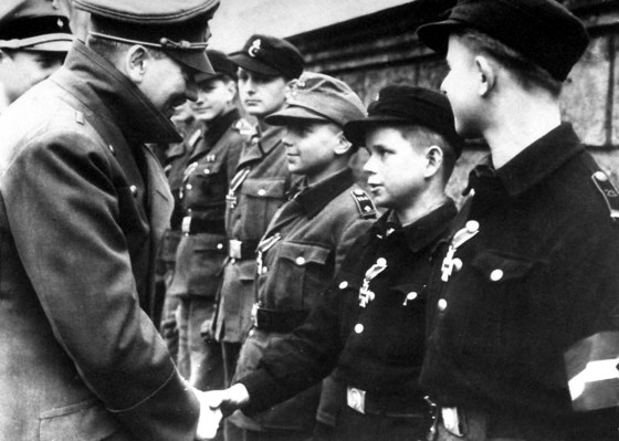Alfred Czech, 12, meets Hitler. April 20, 1945. (Image source: German Federal Archive)