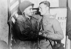Lt. William Robertson and Lt. Alexander Silvashko embrace in a staged photo by the River Elbe, April 25, 1945. (Image source: WikiCommons)